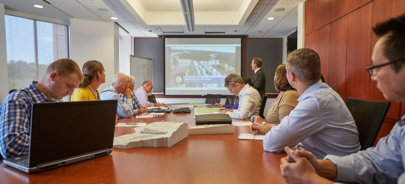 Group of people around conference table in a meeting