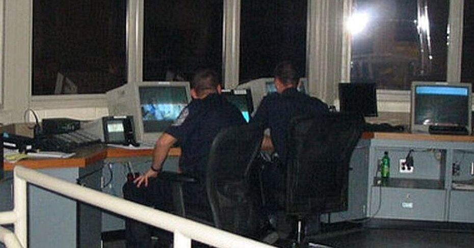 two police men looking at computer screens